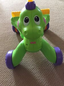 **Fisher Price Sit or Stand Dinosaur walker**