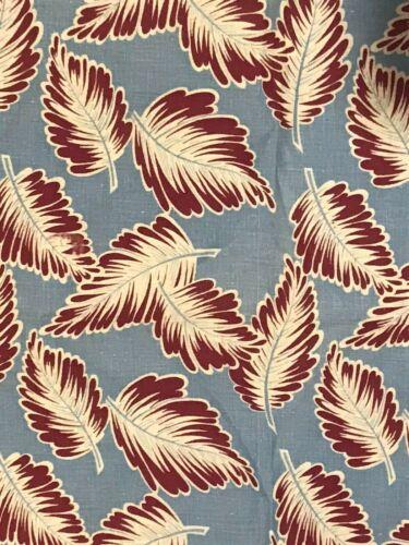 Vintage feed sack fabric, large leaves on blue background