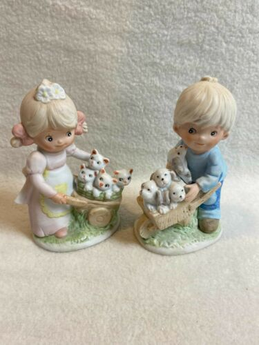 Homco Figurines - Boy and Girl with Puppies and Kittens in Carts