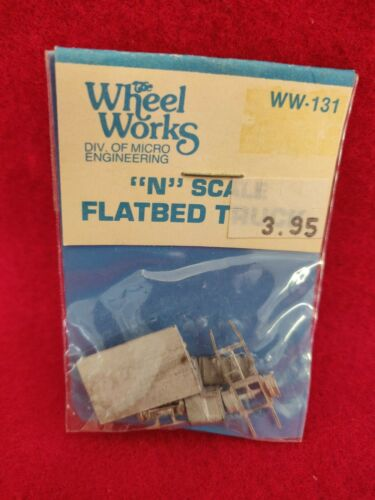 WHEEL WORKS N FLATBED TRUCK