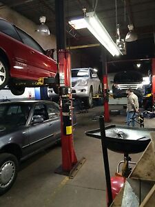 Hoist for rent in a professional Auto mechanic shop