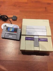 Super SNES Nintendo video game system with Mario world
