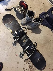 Youth snowboard, boots, helmet and goggles