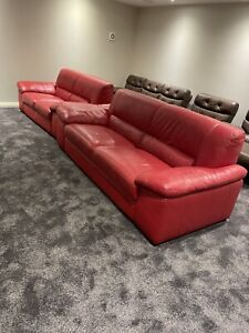 Two leather couches - 3 seater and 2 seater