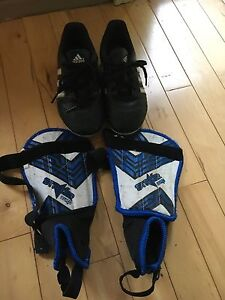 Kids size 13 soccer cleats and shin pads