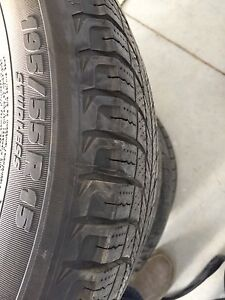 Four 15 inch winter tires and wheels for sale!! Lots of tread!