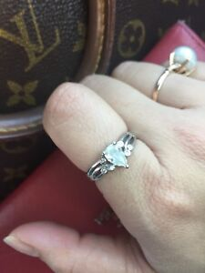 Laser inscribed certified Pear diamond engagement ring