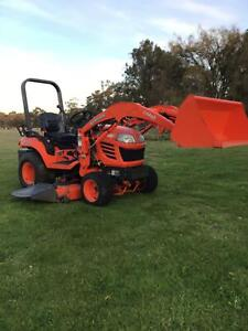 Kubota BX 2350 tractor with loader and deck.