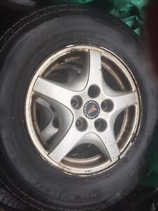 4 summer tires with mags on them asking 125 215 70 15