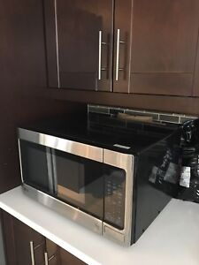 Gray and black LG microwave oven