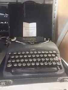 Remington 5t typewriter in case with book and key Shailer Park Logan Area Preview