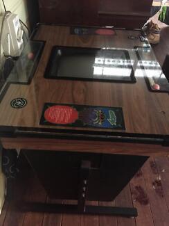 80's vintage cocktail arcade machine