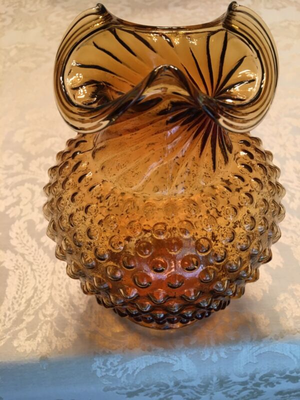 Amber vase with hobnail surface and twisted top