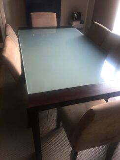 Dinning table and 6 chairs with matching coffee table