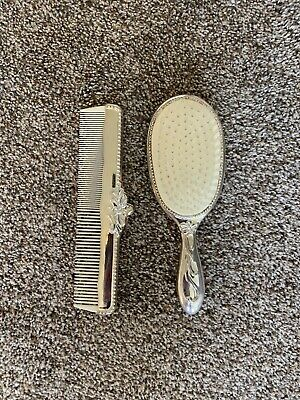 Vintage Ornate Silver plated Brush & Comb set with ivory color plastic teeth