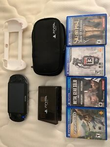 Ps Vita with case, 5 games and controller attachment