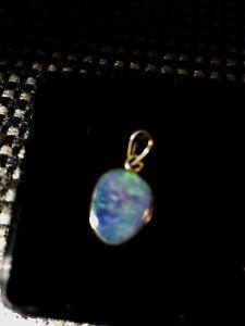 Blue doublet opal pendant set in 14k gold