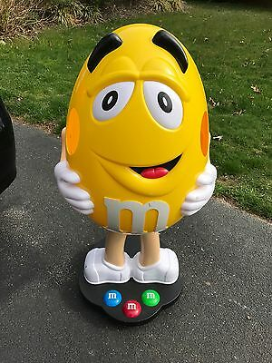 Yellow Peanut M&M giant store display character figure on wheels