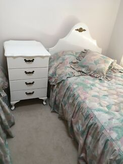 Matching single beds with bedspreads and cushions