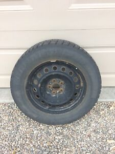 "4 Studded snow tires on 5 on 4"" or 5 on 100mm Steel rims"