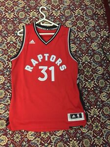New and Unused T-Ross Raptors Jersey