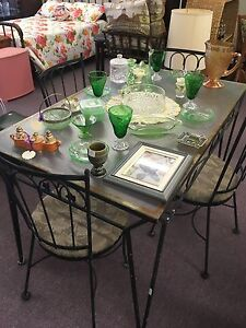 Vintage wrought iron patio table and 4 chairs