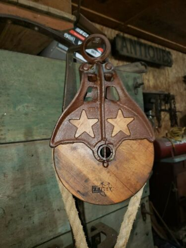 """Antique """"STARLINE""""  VINTAGE CAST Iron/ WOOD PULLEY PRIMITIVE ORNATE . Unique"""