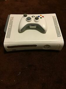 Xbox 360 , plus 21 games and wireless controller