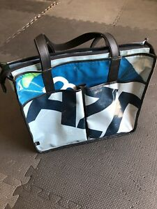 Designer laptop bag made from repurposed billboards