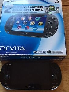 Ps vita with game and case
