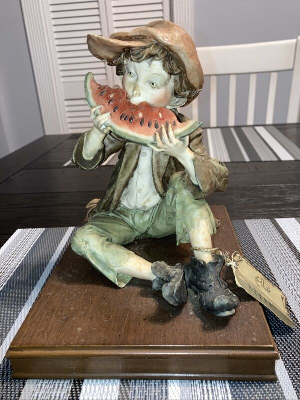 pucci like statue  boy eating watermellon signed!