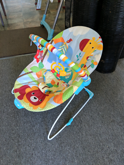 Bright Stars baby rocker with vibration feature and toy bar
