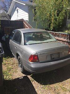 1997 Saturn sedan.