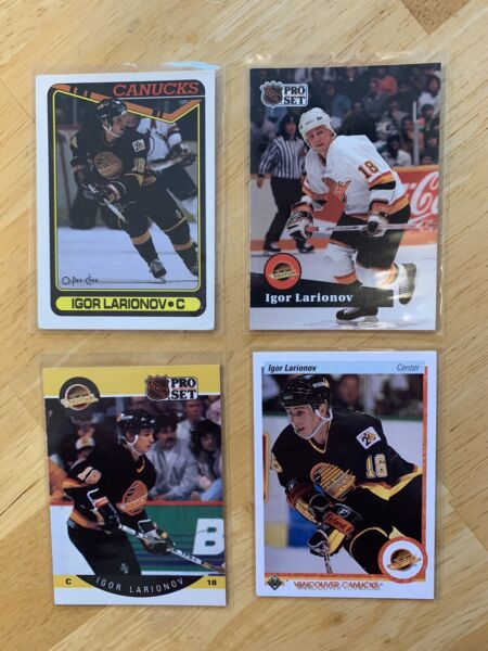 Variety of encased vancouver canucks hockey cards