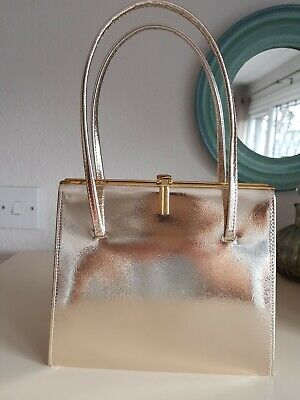 Vintage Gold Evening Bag,with top handles & beautiful clasp Very good condition.