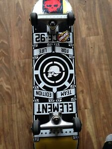 Black and yellow element skateboard