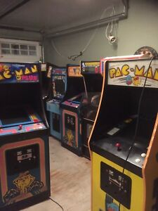 Pac-man by midway arcade machine. Yellow unit left