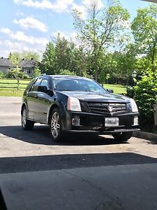 SRX-4 Cadillac. AWD, Navigation, Body performance package