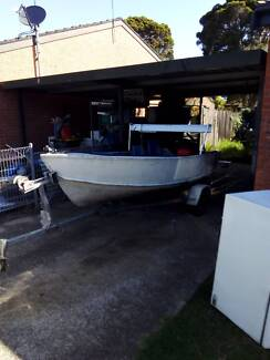 Boat and trailer with 5 hp Mercury