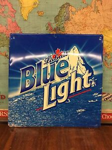 Tin signs. Labatts Blue light. Coca Cola.