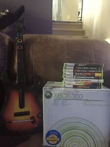 xbox 360 with games and guitar