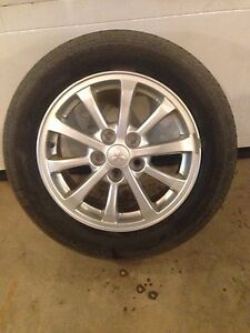 Mitsubishi rims and motomaster tires 205/60/16
