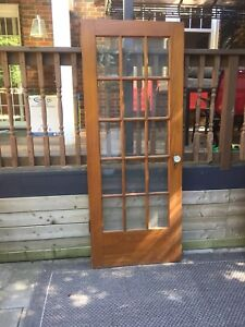 Two antique solid wood French doors