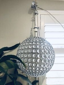 Two metal and glass pendant ceiling lights