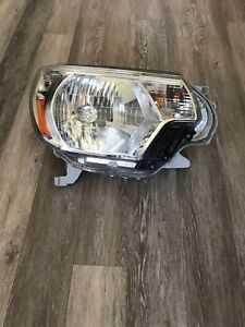 2013 Toyota Tacoma headlights (pair) with 3M covering