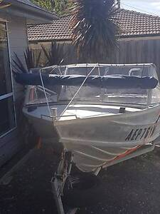 TINNIE 14 FOOT WITH GOOD TRAILER AND NEW BIMINI Melbourne CBD Melbourne City Preview