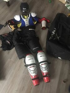 LIGHTLY USED MENS HOCKEY EQUIPMENT