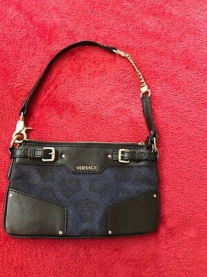 Blue Versace small handbag with black leather accents and brass hardware