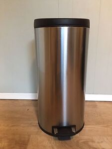 Stainless steel kitchen garbage can.