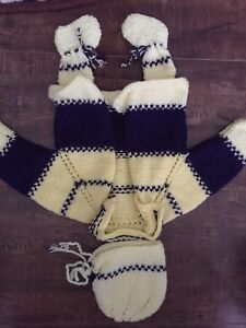 Handmade knit outfits. Super soft. Great baby.